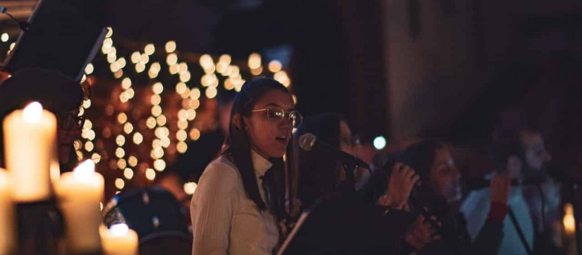 Lady singing at night